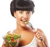 Happy woman eating salad Stock Image