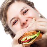 Happy woman eating sandwich Royalty Free Stock Photography