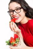 Happy woman eating strawberries Royalty Free Stock Image