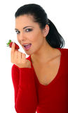 Happy Woman Eating Strawberry. Healthy eating concept. young woman holding strawberry. isolated on white royalty free stock photo
