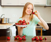 Happy  woman eating strawberry Royalty Free Stock Photo