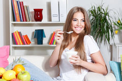 Happy woman eating yogurt Royalty Free Stock Photography