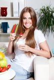 Happy woman eating yogurt with strawberry Stock Image