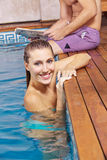 Happy woman on edge of swimming Royalty Free Stock Images