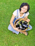 Happy woman with eggplants Stock Photography