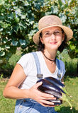 Happy woman with eggplants Royalty Free Stock Images