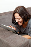 Happy woman with electronic tablet Stock Image