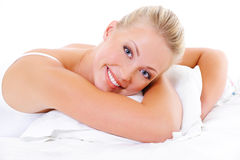 Happy woman embrace the white pillow Royalty Free Stock Photos