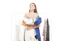 Happy woman embracing clothes Royalty Free Stock Photo
