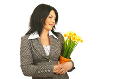 Happy woman embracing flowers Royalty Free Stock Image