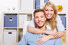 Happy woman embracing man Stock Photos