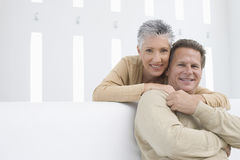 Happy Woman Embracing Man From Behind Royalty Free Stock Photos