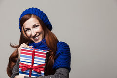 Happy woman embracing a pile of Christmas gifts Royalty Free Stock Images
