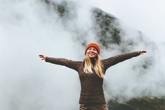 Happy woman emotional raised hands foggy mountains Royalty Free Stock Images