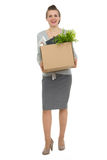 Happy woman employee with box with personal items Royalty Free Stock Image