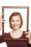 Happy woman in empty frame Royalty Free Stock Photo