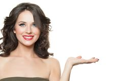 Happy woman with empty open hand isolated, advertising marketing or product placement concept.  royalty free stock photography