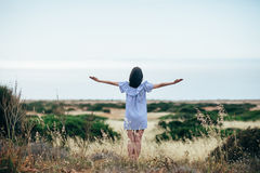 Happy woman enjoy beautiful valley and sea landscape Stock Images