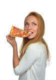 Happy woman enjoy eating slice of pepperoni pizza with tomatoes Stock Images