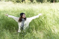 Happy woman enjoy and relax with the nature royalty free stock photography