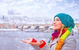 Happy woman enjoy snowfall Stock Photography