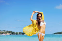 Happy woman enjoying at the beach, summer vacations concept Royalty Free Stock Images