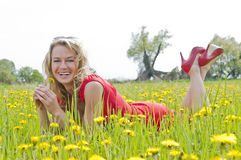 Happy woman enjoying buttercup field Stock Photos
