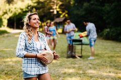 Happy woman enjoying camping Stock Photo
