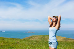 Happy woman enjoying coast vacation travel Stock Photography