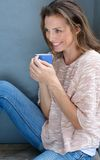 Happy woman enjoying cup of coffee Stock Image