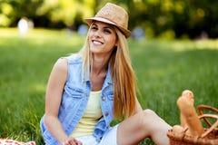 Happy woman enjoying free time on picnic stock photo