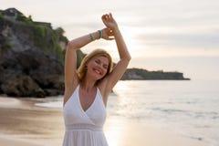 Happy woman enjoying freedom on the beach royalty free stock photo