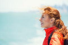 Happy woman enjoying freedom at ocean side on a boat stock image