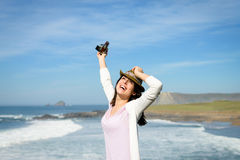 Happy woman enjoying freedom towards the sea Royalty Free Stock Photography