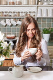 Happy woman enjoying her coffee Stock Photos