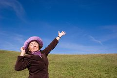 Happy woman enjoying life :). Mature and cheerful, joyful and happy woman enjoying life on a meadow, pointing at something/ showing something with her hand stock images
