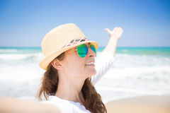Happy woman enjoying life at the beach Stock Photography