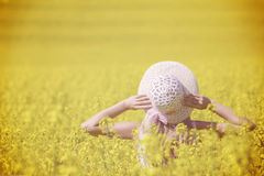 Happy woman enjoying the life in the field with flowers. Nature beauty and colorful field with rape. Outdoor lifestyle. Freedom co. Ncept. Woman in summer field royalty free stock image