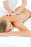 Happy woman enjoying a massage Stock Photo