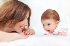 Happy woman enjoying motherhood Stock Images