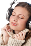 Happy woman enjoying music with headphones Royalty Free Stock Photo