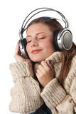 Happy woman enjoying music with headphones Stock Photography