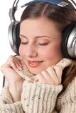 Happy woman enjoying music with headphones Royalty Free Stock Photography