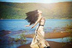Happy woman enjoying nature Stock Image