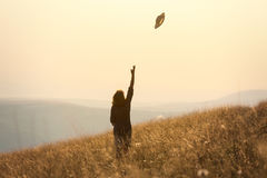Girl hiking on mountain and having fun on idyllic field at sunse Royalty Free Stock Image