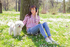 Happy Woman Enjoying Nature With Her Dog Stock Photo