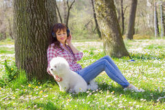 Happy Woman Enjoying Nature With Her Dog Royalty Free Stock Images