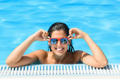 Happy woman enjoying pool in tropical resort on summer Royalty Free Stock Photos