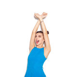 Happy woman enjoying and raising her hands up Royalty Free Stock Images