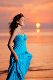 Happy Woman enjoying in Sea Sunset. Royalty Free Stock Images